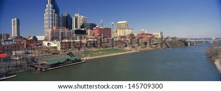 Nashville skyline with Cumberland River the in foreground in Tennessee, USA - stock photo