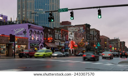 NASHVILLE, TENNESSEE - DECEMBER 1: Late afternoon rain at The District on Broadway on December 1, 2014 in downtown Nashville, Tennessee - stock photo