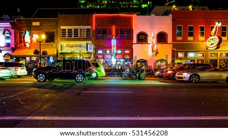 NASHVILLE, TENNESSEE - JULY 7th: Honky Tonk bars and nightlife along Broadway Street in Nashville, Tennessee on July 7th, 2016.