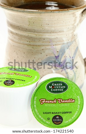 NASHVILLE, TN--JAN 31, 2014: Green Mountain Coffee K-cups. Supporting local and global communities through investing, and donating a portion of its pretax profits to social and environmental projects. - stock photo