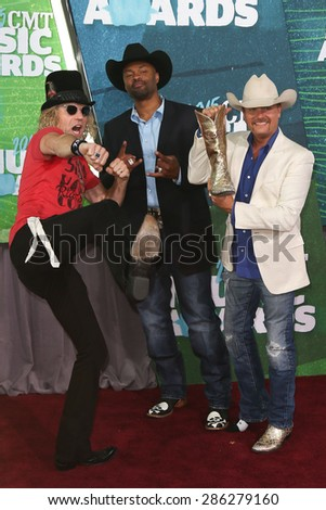 NASHVILLE, TN-JUN 10: (L-R) Big Kenny, Cowboy Troy and John Rich of Big & Rich attend the 2015 CMT Music Awards at the Bridgestone Arena on June 10, 2015 in Nashville, Tennessee. - stock photo