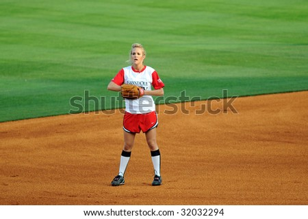 NASHVILLE, TN - June 10, 2009: Country music superstar Carrie Underwood in the field during the CIty of Hope softball game June 10, 2009 in Nashville, Tennessee.
