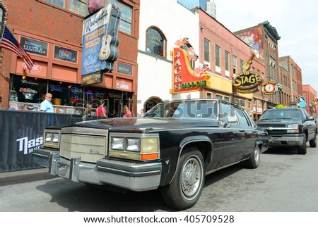 NASHVILLE,TN,USA - SEP 27: 1978 Cadillac Deville at historical Broadway on Sep. 27, 2015 in downtown Nashville, Tennessee, USA. Lower Broadway is famous for entertainment district of country music. - stock photo