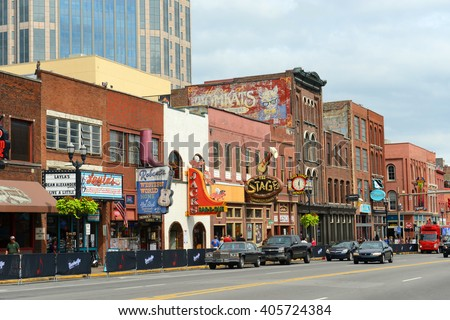NASHVILLE,TN,USA - SEP 27: Honky tonk Bars on historical Broadway on Sep. 27, 2015 in downtown Nashville, Tennessee, USA. Lower Broadway is famous for entertainment district of country music. - stock photo