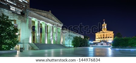 Nashville War Memorial Auditorium and Tennessee State Capitol in Nashville, Tennessee, USA. - stock photo