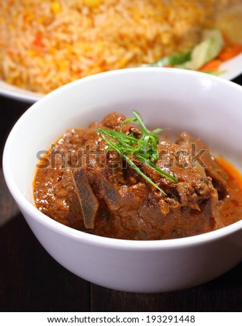 Nasi Briyani is a wholesome rice-based dish prepared with spices, rice, meat and vegetables. - stock photo