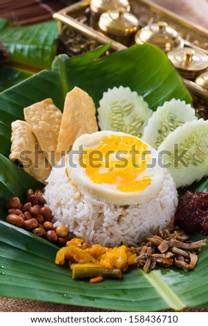 nasi lemak, a traditional malay curry paste rice dish served on a banana leaf  - stock photo