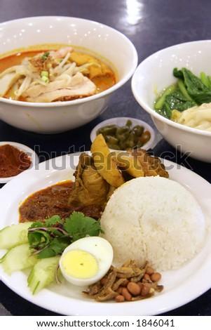 Nasi Lemak, curry mee and Wan Tan soup - stock photo