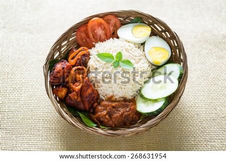 Nasi lemak kukus traditional malaysian spicy rice dish - stock photo
