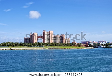 NASSAU, BAHAMAS, DECEMBER 2, 2014: Panoramic of a catamaran and the famous Atlantis Paradise Island Hotel and Casino in Nassau, one of the most exclusives hotels in the world during holidays season. - stock photo