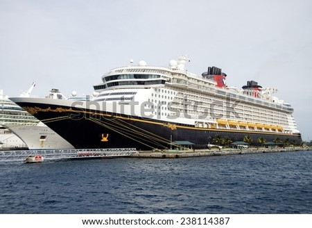 NASSAU, BAHAMAS, DECEMBER 2, 2014: World famous Disney Dream cruise ship docked at the Port of Nassau taking thousands of tourists with Disney's magic to the Caribbean during the holiday season.