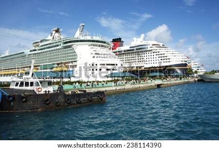 NASSAU, BAHAMAS, DECEMBER 2, 2014: World famous Royal Caribbean and Disney Dream cruise ships docked at the Port of Nassau taking thousands of tourists to the Caribbean during the holiday season. - stock photo