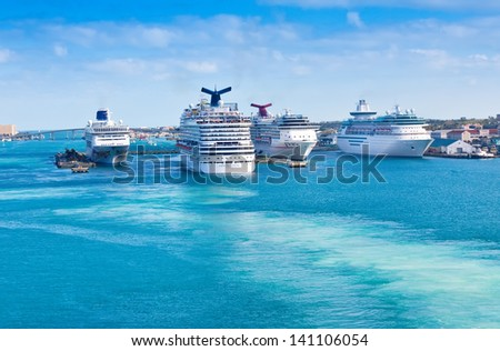 NASSAU, BAHAMAS - JAN. 13:  Carnival Cruise Lines, and other cruise lines, in port on Jan. 13, 2013.  Many cruise lines frequents the Bahamas as it's one of the world's most famous travel destination. - stock photo