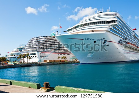 NASSAU, BAHAMAS - JAN. 13: Numerous cruise ships docked at the Bahamas port of call on Jan. 13, 2013.  Most cruise lines include the islands of the Bahamas as a destination point on their itineraries. - stock photo