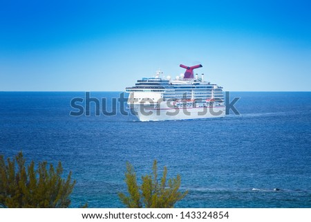 NASSAU, BAHAMAS - JAN.13:  The Carnival Miracle approaches the port of Nassau on Jan. 13, 2013.  Carnival Cruise Lines frequents the Bahamas as it's one of the world's most famous travel destination. - stock photo