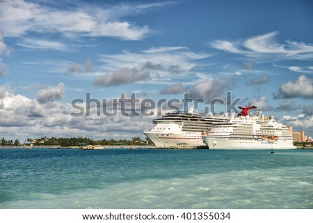 Nassau, Bahamas - January 07, 2016: Cruise ship Carnival Pride of Carnival Cruise Lines and luxury cruise ship Seven Seas Navigator of Regent Seven Seas Cruises standing in bay sunny day - stock photo
