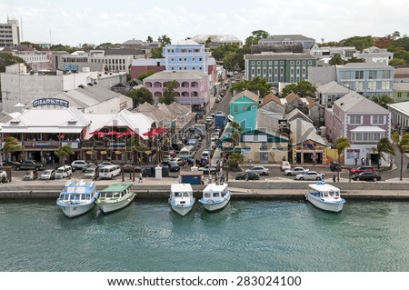 NASSAU, BAHAMAS - MAY 27, 2015: Nassau Bahamas busy tourist district with boat shuttles tied up waiting for tours - stock photo