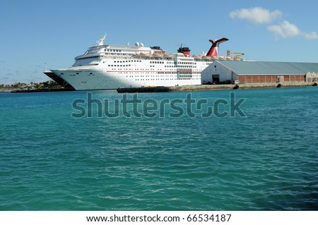 NASSAU, BAHAMAS - NOVEMBER 29: The Carnival Cruise Ship Fascination, at dock on November 29, 2010 in Nassau, Bahamas. She is one of 8 sister ships and received a million dollar refurbishment in 2006 - stock photo