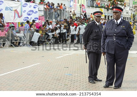 NASSAU, THE BAHAMAS - JANUARY 1: Policemen at Junkanoo Festival on January 1st 2014 in Nassau, the Bahamas
