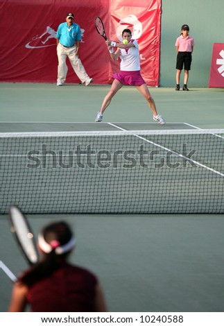 """Nathalie Dechy of France playing Shuai Peng at the Qatar Open, February, """"008 - stock photo"""