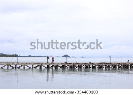 Nathon pier at Koh Samui, on the cloudy day. - stock photo