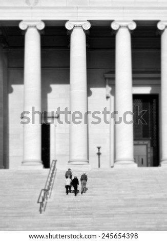 National Archives in Washington DC with columns and people walking up stairs - stock photo