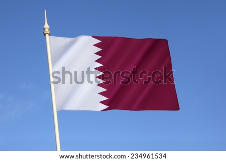 National flag and ensign of Qatar - The flag was officially adopted on 9th July 1971, although a almost identical flag (only differing in proportion) had been used since 1949. - stock photo
