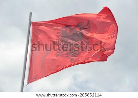 National flag of Albania on a pole - stock photo