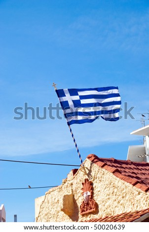 National flag of Greece on a roof - stock photo