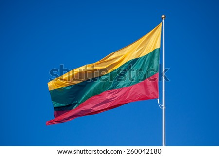 National flag of Lithuania, consisting of a horizontal tricolor of yellow, green and red. - stock photo