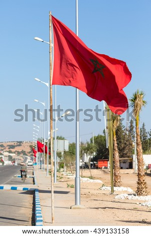 National flag of Morocco in Tleta-El Henchane on the road from Marrakech to Essaouira - stock photo