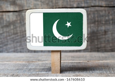 National flag of Pakistan on Small wooden framed blackboard on wooden background - stock photo
