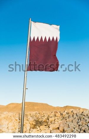 National flag of Qatar on flagpole