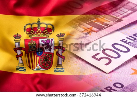 National flag of spain and euro banknote - concept. Euro coins. Euro money. Euro currency - stock photo