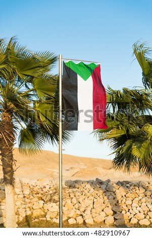National flag of Sudan on flagpole