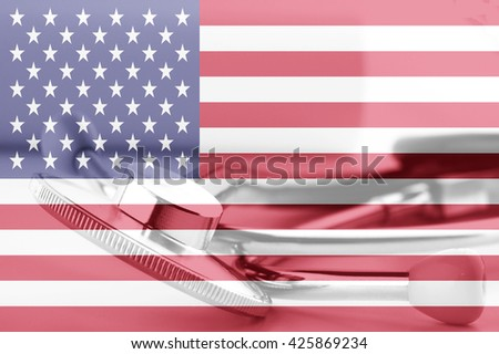 National flag of United States and stethocope. American medicine concept - stock photo