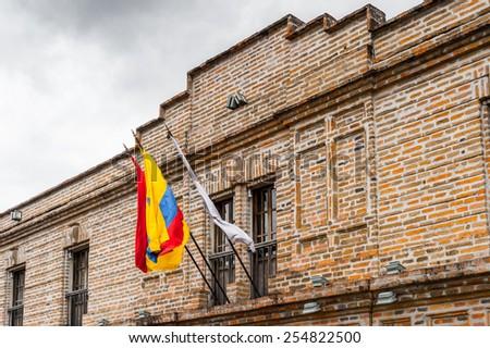 National flag on a balcony of a building of Cuenca, Ecuador - stock photo