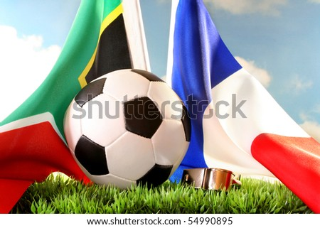 National flags and a football against a cloudy sky