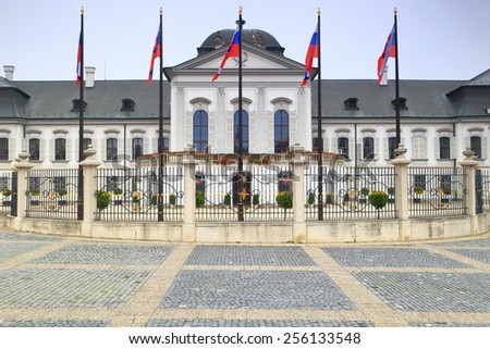 National flags near the front side of Presidential Palace (Grassalkovich Palace), Bratislava, Slovakia - stock photo