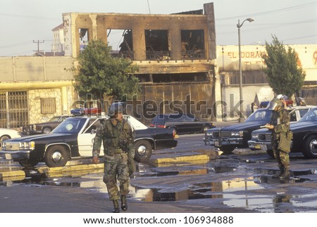 National Guardsmen and police cars patrolling during 1992 riots, South Central Los Angeles, California - stock photo
