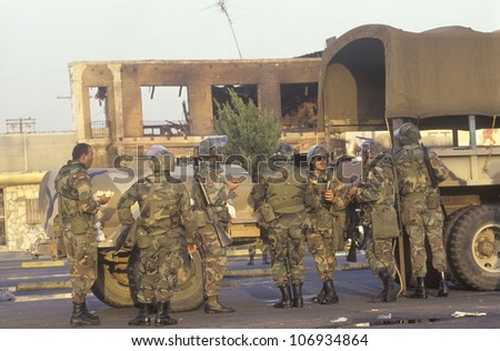 National Guardsmen taking meal break, 1992 riots, South Central Los Angeles, California - stock photo
