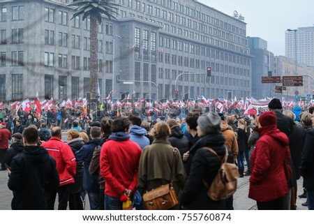 National Independence Day in Poland, group of people carrying flags on the street, Warsaw, Poland, 2015 November 11