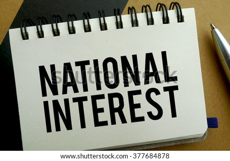 National interest memo written on a notebook with pen