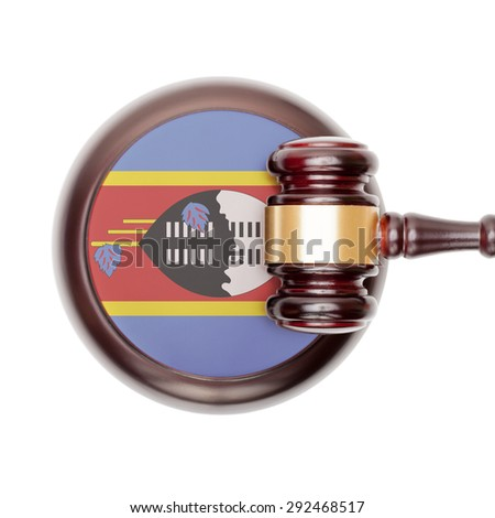 National legal system concept with flag on sound block  - Swaziland