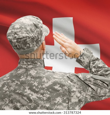 National military forces with flag on background conceptual series - Switzerland - stock photo