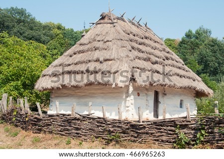 National Museum of Folk Architecture and Life Pirogovo. Traditional wattle and daub hut with thatched roof