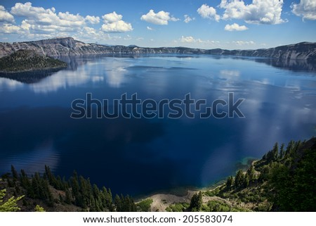 National Park,  Crater Lake, Oregon, lake with partly covered with ice - stock photo
