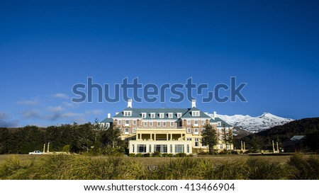 NATIONAL PARK, NZ - AUG 8 2013: Chateau Tongariro.It's located close to Whakapapa skifield on the slopes of Mount Ruapehu within the boundaries of Tongariro National Park. - stock photo