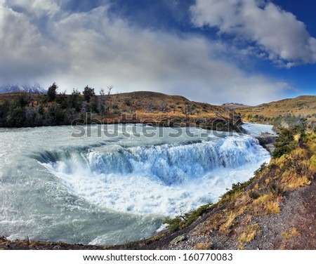 National Park Torres del Paine in Chile.  The raging waterfall on the Rio Paine.