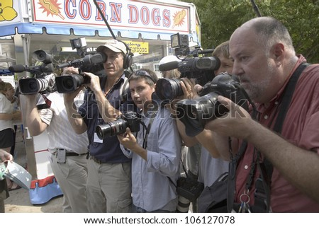 National press following former U.S. Senator and actor of Law & Order, Fred Thompson at Iowa State Fair to campaign for U.S. President, August 17, 2007, Des Moines, Iowa - stock photo